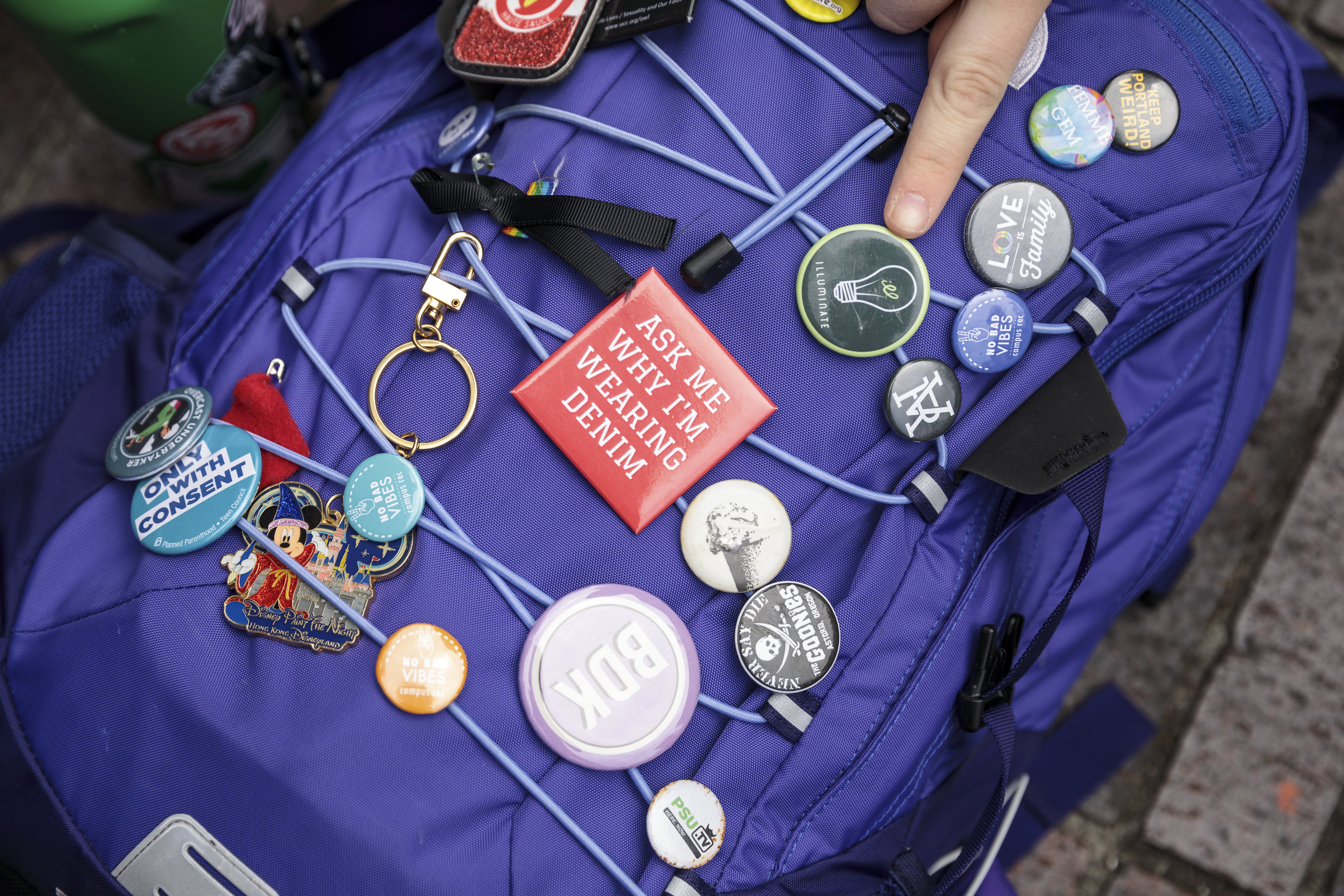 Student backpack with buttons