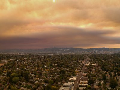 Photo of downtown Portland, Oregon with an orange/gray sky caused by smoke from wildfires