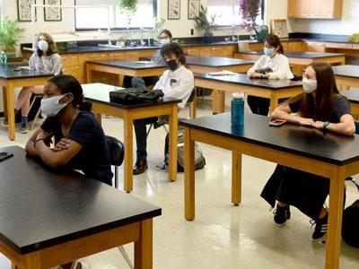 Young children sitting at school desks