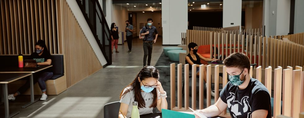 Students wearing face masks studying